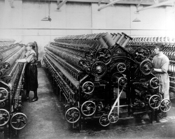 Photograph of two female spinning operators working at M.P. Stonehouse in Albion Mills in Wakefield in 1923